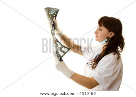 Female Doctor Looking At Xray