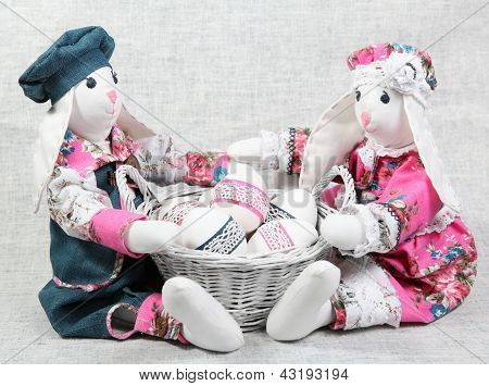 Two Easter Bunnies With Basket Of Eggs