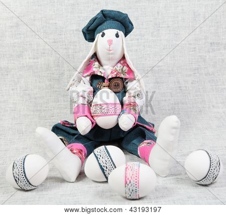 Easter Bunny Male Holding Decorated Egg