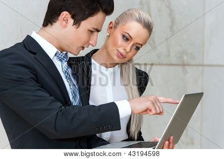 Businessman Reviewing Work With Female Colleague.