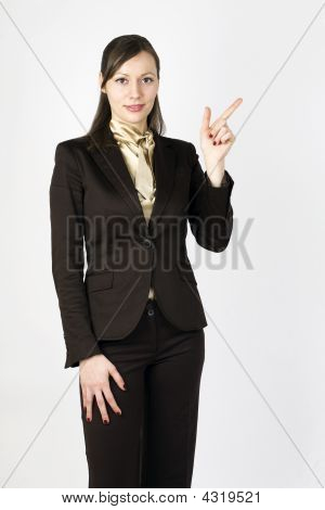 Woman Pointing With Her Finger To The Left