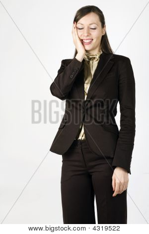 Happy Woman With Hand On Her Face