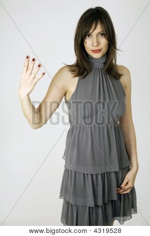 Fashion Model Showing With Her Hand The Number Four