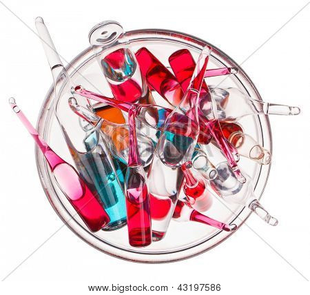 Medical ampoules in glass bowl isolated on a white