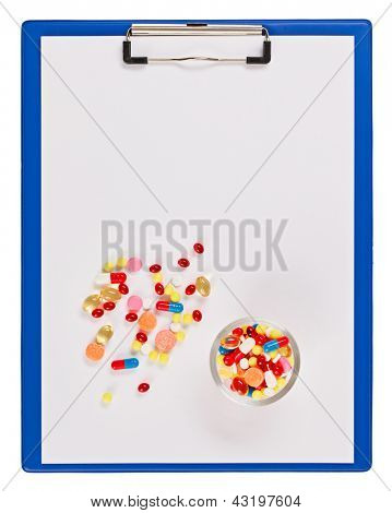 Blue medical clipboard with pills and tablets isolated on white