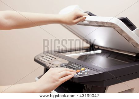 Woman's Hands With Copier