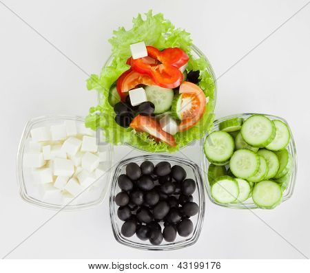 Picture Of Plates With Greek Salad And  Ingredients