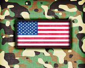 stock photo of ami  - Amy camouflage uniform with flag on it USA - JPG