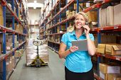 pic of dispatch  - Businesswoman Using Digital Tablet In Distribution Warehouse - JPG