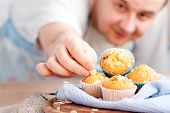 image of chocolate muffin  - Chef is decorating delicious organic muffins - JPG