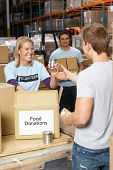 picture of tin man  - Volunteers Collecting Food Donations In Warehouse - JPG