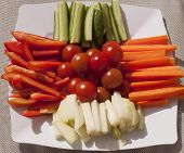 image of crudites  - Closeup of assorted fresh raw vegetables on a white platter - JPG