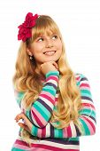 stock photo of teen pony tail  - Thoughtful blond girl smiling dreaming and thinking about something - JPG