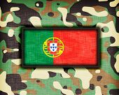 stock photo of ami  - Amy camouflage uniform with flag on it Portugal - JPG