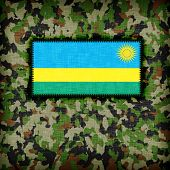 stock photo of ami  - Amy camouflage uniform with flag on it Rwanda - JPG