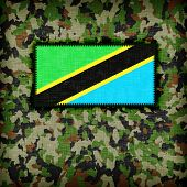 stock photo of ami  - Amy camouflage uniform with flag on it Tanzania - JPG