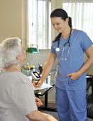 picture of hospital patient  - young nurse with senior patient in hospital - JPG