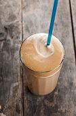 pic of frappe  - Greek coffee cold Frappe drink on a wooden table - JPG
