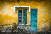 stock photo of grating  - Outside view of deserted house with details in Vietnam - JPG