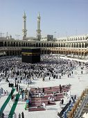 Kaaba Mecca in Saudi Arabia and Muslim pilgrims coming for Hajj (very rear images from inside the ho