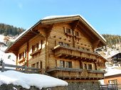 pic of chalet  - Taken high in the southern alps of Switzerland just as the face of the chalet was shaded from the bright sun - JPG