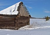 stock photo of sag  - Country view and old wooden barn with a snow - JPG