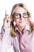 stock photo of dorky  - Dorky Businesswoman Wearing Taped Glasses And Striped Stereotype Shirt And Tie Gesturing A Inventive Idea - JPG