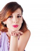 stock photo of auburn  - Attractive young woman with auburn hair blowing kiss white background with copy space - JPG