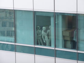 image of exhibitionist  - looking at a window of a building in Manhattan with mannequins - JPG