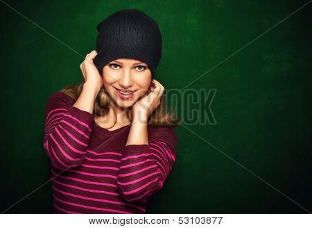 Young Beautiful Happy Girl Teenager In A Black On A Green Background
