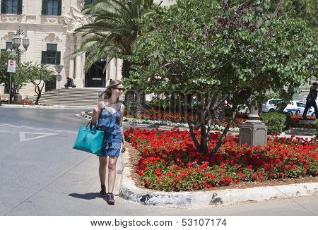 Woman Crossing Street In Malta