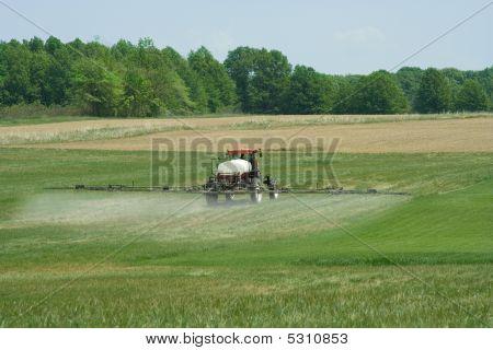 Spraying Grass Killer On Crops