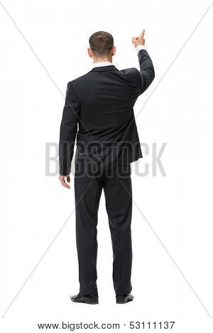Full-length backview portrait of business man attention gesturing, isolated on white. Concept of leadership and success