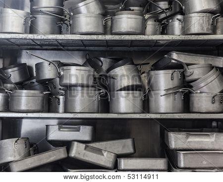 Shelf full of pans all in chrome
