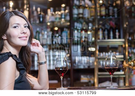 Beautiful Woman Seated At A Bar Counter