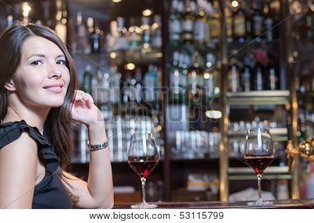 Beautiful Woman Seated At A Bar Counter