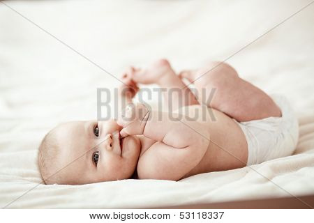 Portrait of a cute 3 months baby lying down on a blanket