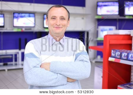 Elderly Man With  Crossed Hands In Radio Engineering Shop