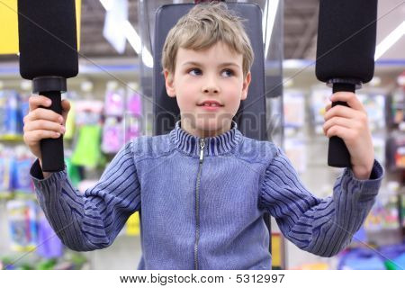 Boy In Shop On  Sports Exerciser