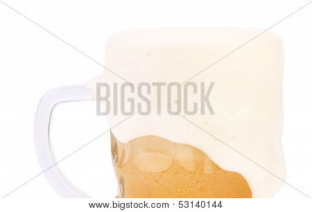 Mug of beer with froth close-up