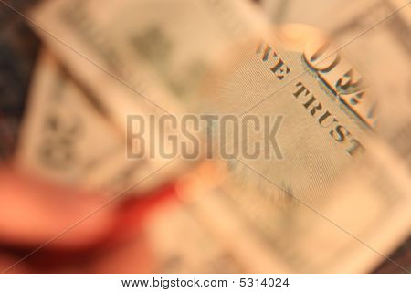 100 Usd  The Banknote Is Under The Examination Of A Magnifying Glass