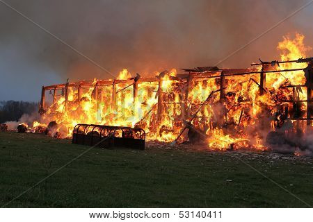 Burning farm with 1000 tons hay in village.
