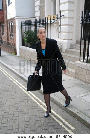 Business Woman Crossing The Road