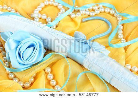 Beautiful hanger on fabric background