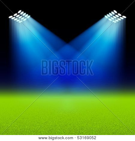 Bright spotlights illuminated green field stadium. Vector.