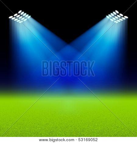 Bright spotlights illuminated green field stadium. Vector.