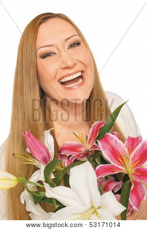smiling xxl female holding flowers on white background
