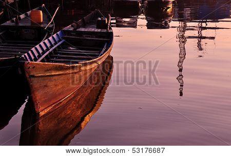 Canoe Reflection at Sunrise