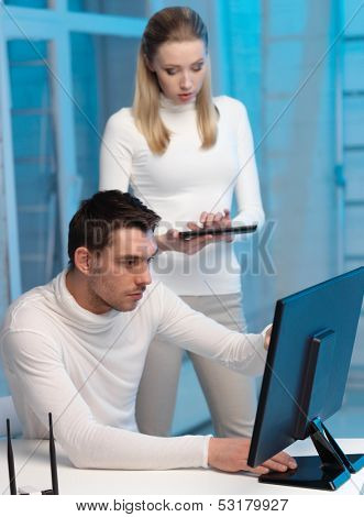 business, internet, technology, computers, science communication concept - woman and man with computer in the lab