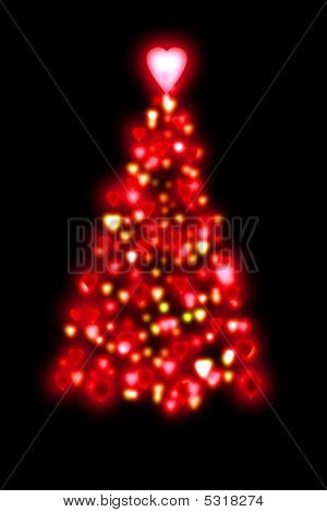 Red Christmas Tree Shape From Glowing Red Hearts